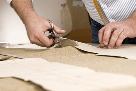 Tailor working at studio cutting fabric, detail of hand with scissors Stock Photo - 11871568