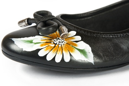 black women shoes with printed flower on white background photo
