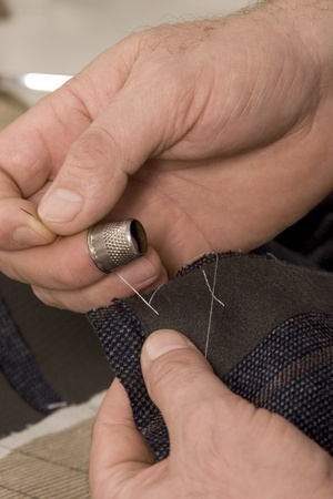 detail of sewing hand in tailor studio Stock Photo - 11985087