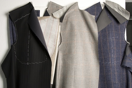 tailor suit: piece of fabric and pattern ready to be assembled in suit, tailor studio
