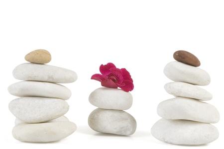 white pebble: zen stones with red flower on white  Stock Photo