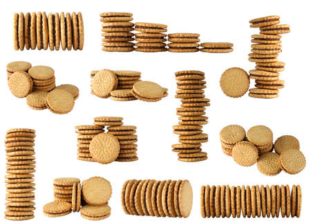 round biscuits arranged in different shape on white background photo