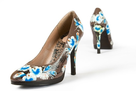 brown women high heels shoes with printed flower on white background photo