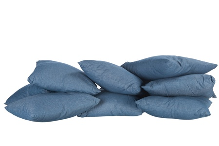 stack of blue denim pillows isolated on white