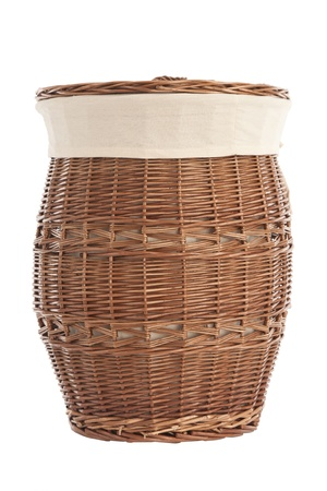 Isolated on white laundry basket made of rattan photo