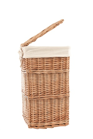 Isolated on white laundry basket made of rattan photo