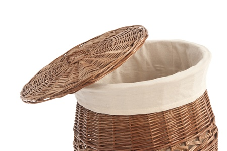 wickerwork: Isolated on white laundry basket made of rattan