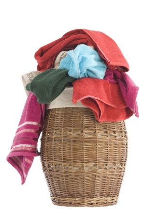 colorful towels in a basket isolated on white background  photo