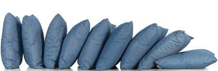in a row blue denim pillows isolated on white photo