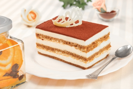 tiramisu dessert on plate and silver spoon photo
