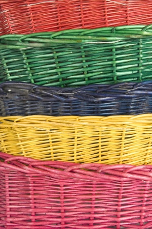 stack of isolated on white woven straw baskets photo
