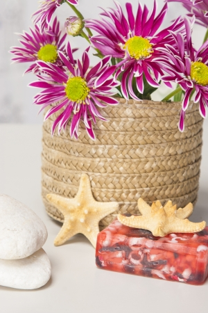 Spa setting with natural soaps and flower on blue strips background Stock Photo - 16612391