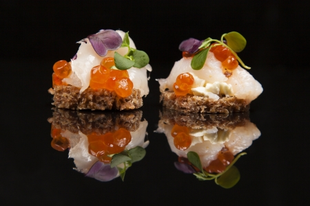 canapes: fresh salmon, cheese, and herbs canapes, Japanese meal, healthy food concept