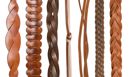 leather belt: Closeup of various brown leather belts isolated on white background Stock Photo