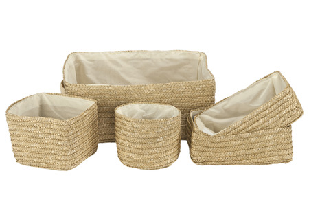 Various braided bamboo baskets with inner cotton fabric isolated on white photo