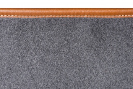 detail of sewn beige leather binding on grey rug Stock Photo - 25032215