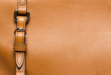 macro detail of yellow leather with a closed buckle Stock Photo