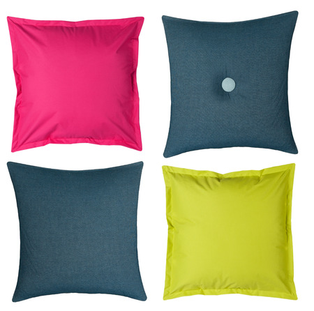 four colored pillows isolated on white background
