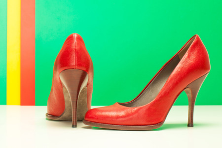 pair of red high heels on green and stripes background photo