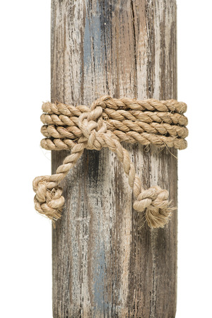 nautical rope: wrapped rope on wood over white background