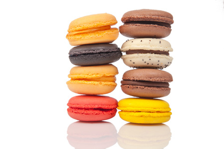 Colorful macaroons, French pastry on white background photo