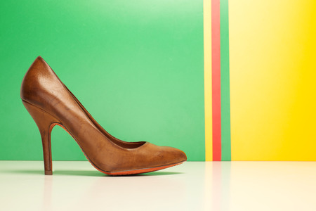 brown high heels on yellow and green background photo
