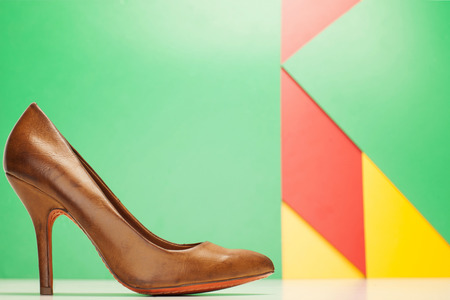 brown high heels shoes on green background photo