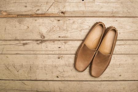 moccasin: Mens Loafer Shoe on old wood background