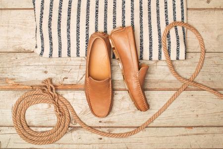 Mens Loafer Shoe on old wood background