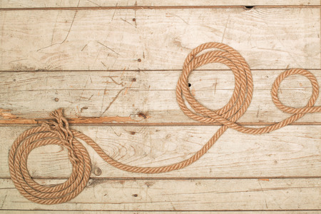 barnwood: old texture of wooden boards with ship rope