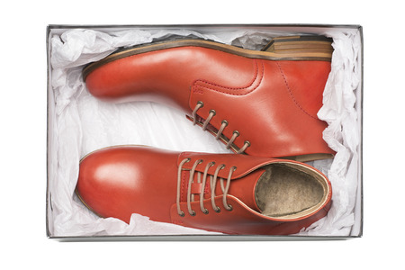 dress shoes: new red shoes in box with wrapping paper
