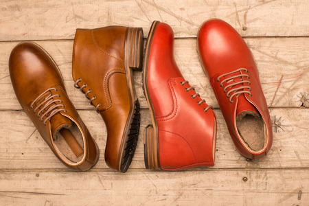 chamois leather: Men Brown Shoes on wooden background