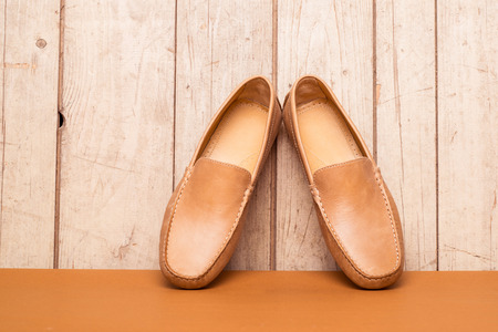 chamois leather: Mens Loafer Shoe on old wood background