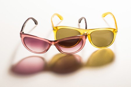 tinted: sunglasses on white background with long shadow