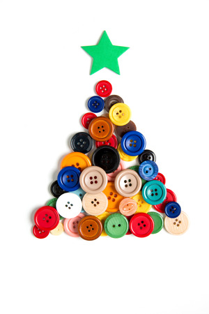 christmas isolated: Christmas tree made with colored buttons, isolated on white background