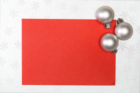 chritmas: card with chritmas balls on silver snowflakes background