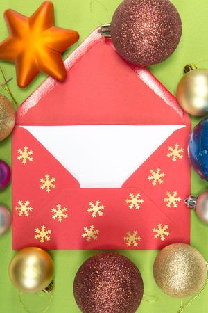 christmastime: red envelope on green background, christmastime