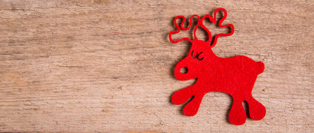 rudolf: christmas card with  decor and rudolph reindeer on wood background