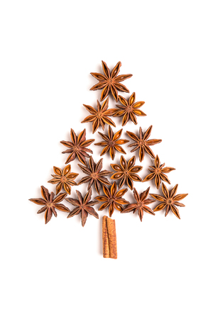 christmas scent: Christmas tree of cinnamon sticks and star anise isolated on white background