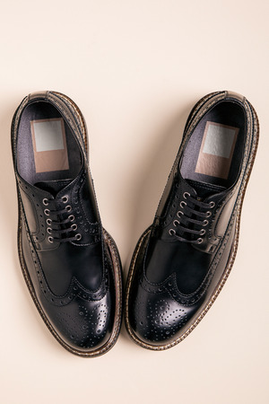 brogues: New pair of man brogues shoes on a gray background.