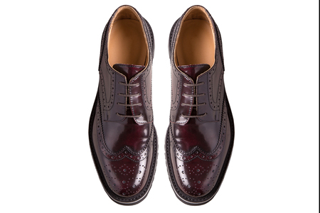 dress shoe: New pair of man brogues shoes on a gray background.