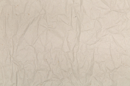 creased: Texture of crumpled packaging gray paper background, creased and folded