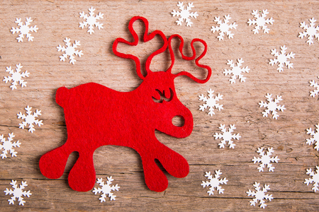 rudolph: christmas card with  decor and rudolph reindeer on wood background