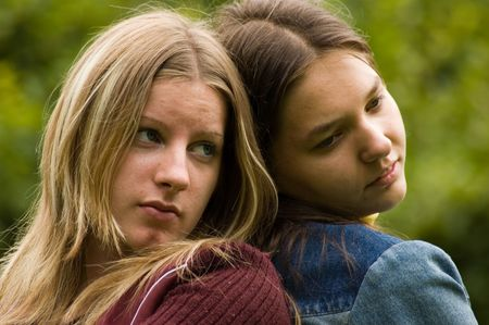 two young girl sitting in park photo