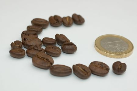 an euro symbol made with java beans and euro coin Stock Photo - 371980