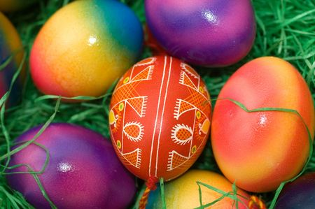 eastertime: several colored easter eggs laying on the green grass
