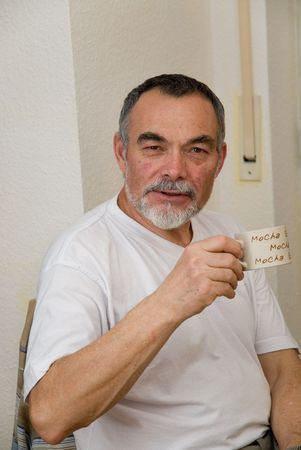 elderly man in white t-shirt drinking coffee Stock Photo - 696693