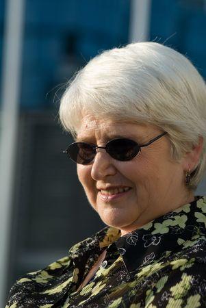 sunnies: elderly woman in dark glasses Stock Photo