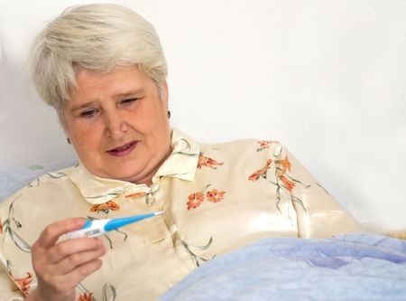 sickly: elderly woman with thermometer