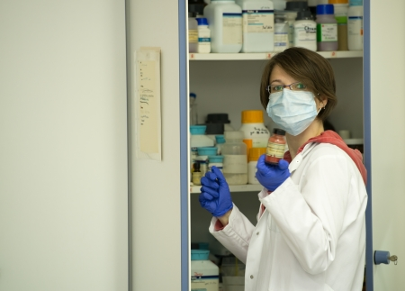 Young woman preparing solutions in laboratory photo